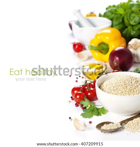 Bowl of healthy white quinoa seeds with vegetables over white - stock photo