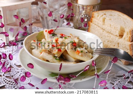 bowl of herring salad with onion and red pepper in oil for christmas - stock photo