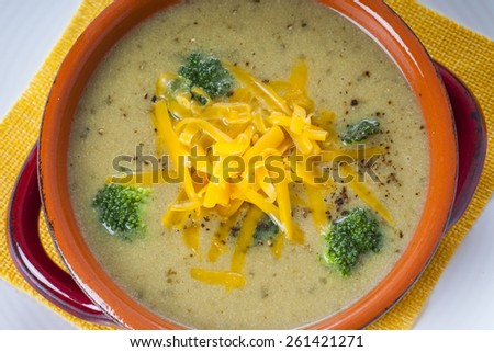 Bowl of homemade Broccoli and Cheddar Cheese Soup - stock photo