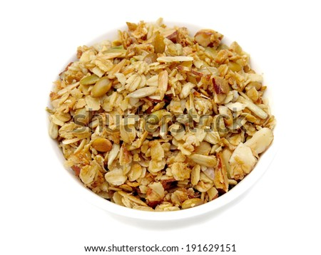 Bowl of homemade granola with pumpkin and sunflower seeds and almonds - stock photo
