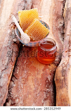 bowl of honey with honey comb - food and drink - stock photo