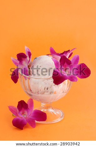 bowl of ice cream with natural eatable orchid