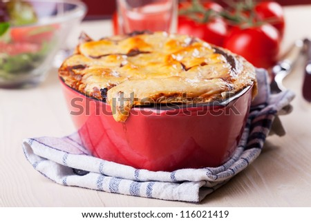 bowl of lasagna with tomatoes - stock photo