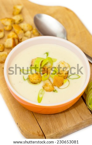 Bowl of Leek and Potato soup with croutons. Selective focus.