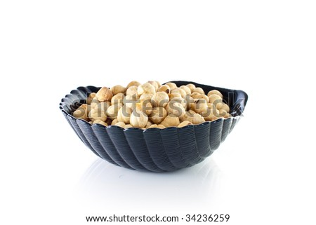 Bowl of macadamia nuts - stock photo