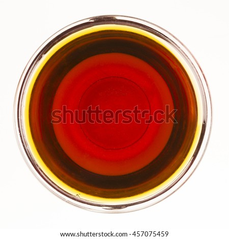 Bowl of maple syrup isolated on a white background.