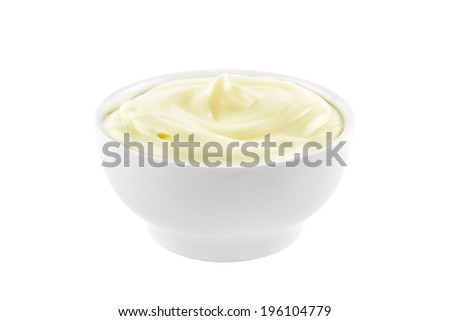 Bowl of mayonnaise isolated on white