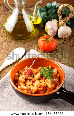 Bowl of Mexican beans on complex background