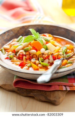 Bowl of minestrone soup with bread - stock photo