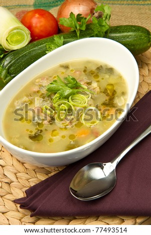 bowl of minestrone with fresh vegetables - stock photo