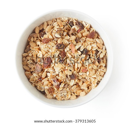 Bowl of muesli isolated on white background, top view - stock photo