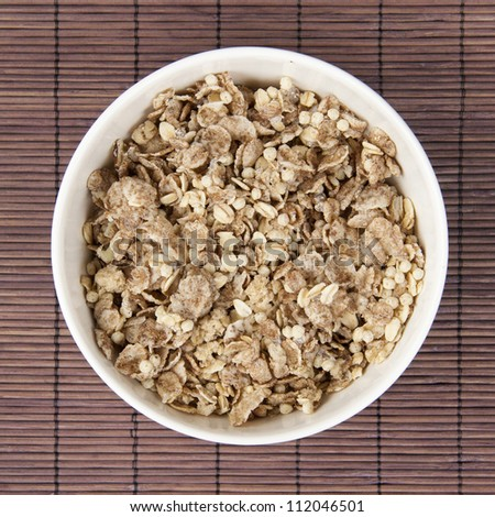 Bowl of muesli with almonds, nuts and granola. - stock photo