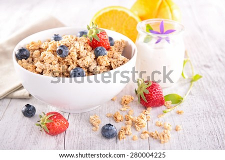 bowl of muesli with berries fruits - stock photo