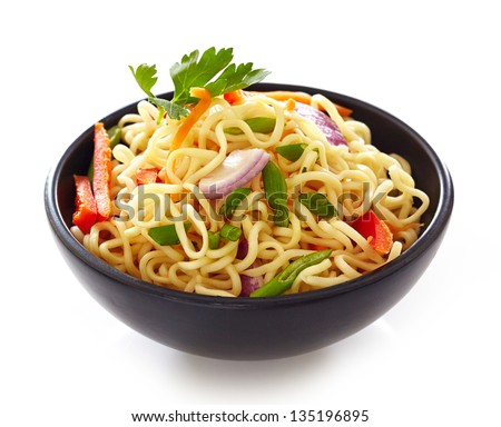 bowl of noodles with vegetables isolated on white - stock photo