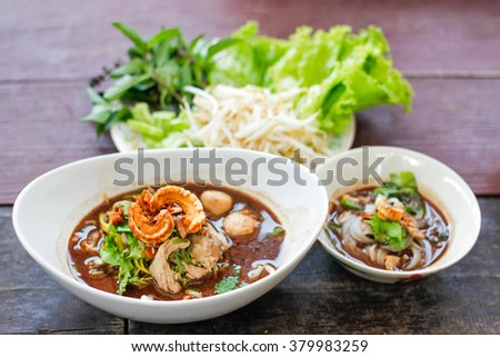 bowl of noodles with vegetables on wooden table. delicious noodle. Instant noodle. hot noodle.Homemade Quick Ramen Noodles,selective focus  - stock photo