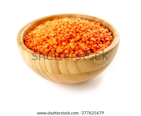Bowl of nutritious red lentils studio isolated - stock photo