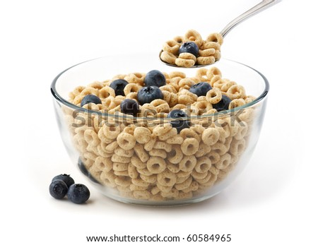 Bowl of oat cereal with blueberry and spoon - stock photo
