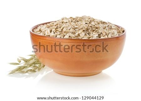 bowl of oat flake isolated on white background - stock photo