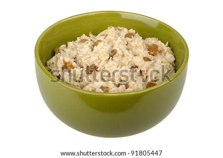 Bowl of oatmeal cereal with raisins isolated on white background - stock photo