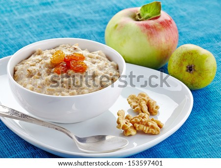 Bowl of oats porridge. Healthy breakfast