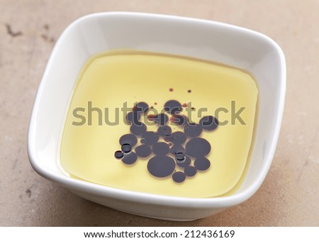 bowl of olive oil and balsamic vinegar - stock photo