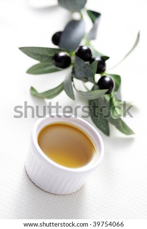 bowl of olive oil with salt and pepper - food and drink