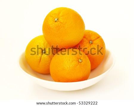 bowl of orange sunkist in white - stock photo