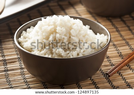 Bowl of Organic White Rice with chop sticks - stock photo