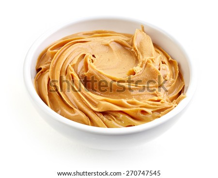 bowl of peanut butter isolated on white background - stock photo