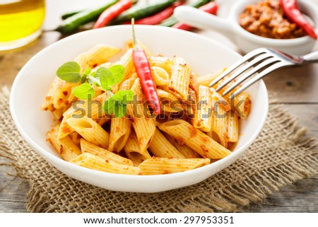 Bowl of penne with homemade chili pesto - stock photo