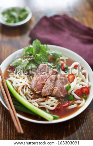 bowl of pho with beef, vietnamese soup - stock photo