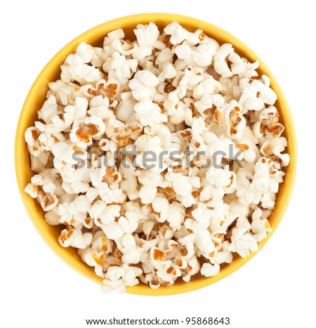 Bowl of popcorn isolated on white background. Top view - stock photo