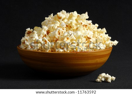 Bowl of popcorn with a dark background - stock photo