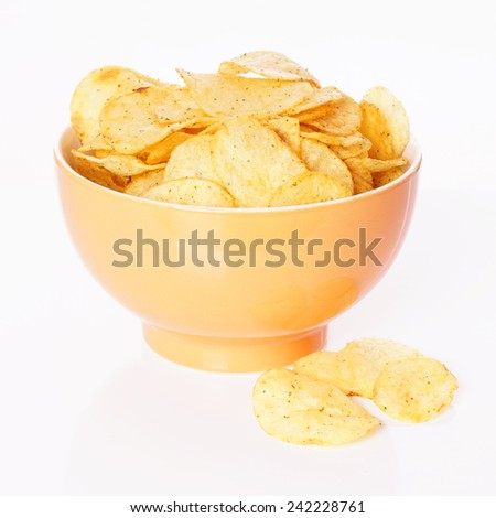 bowl of potato chips or crisps - stock photo
