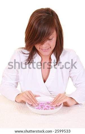 bowl of pure water and spring flowers - beauty treatment - stock photo