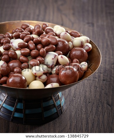 bowl of raisins and nuts covered with chocolate