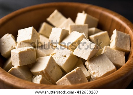 Bowl of raw tofu cubes as food background - stock photo