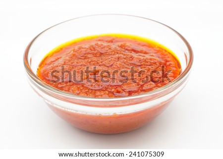 bowl of red hot chilli pepper sauce or Malaysian Sambal on white background - stock photo