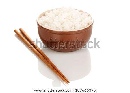 Bowl of rice and chopsticks isoalted on white - stock photo
