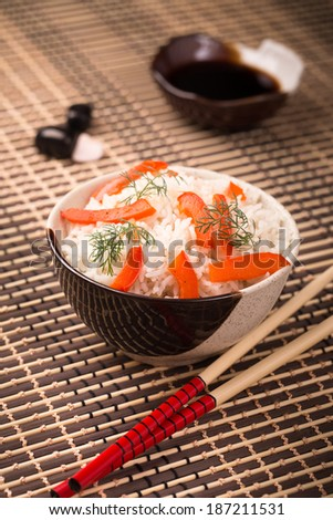Bowl of rice, chopsticks and soy sauce - stock photo