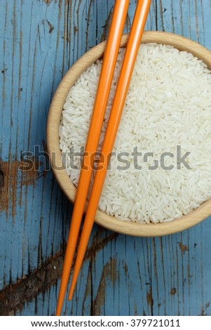 Bowl of rice with chopstick - stock photo