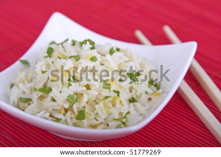 Bowl of rice with chopsticks - stock photo