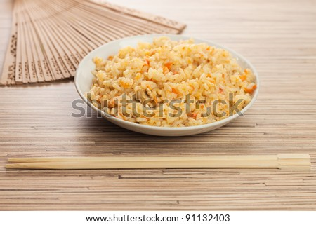 bowl of rice with chopsticks and fan - stock photo
