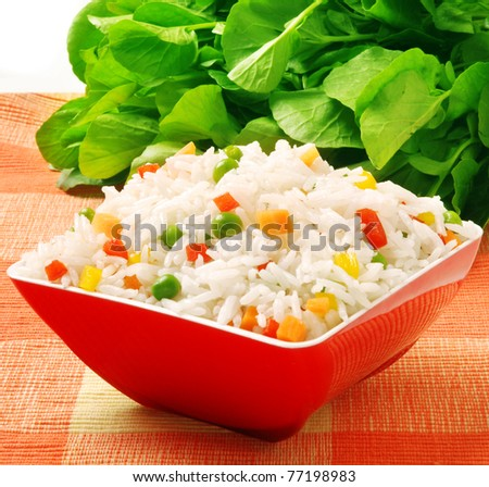 bowl of rice with peas and red peppers - stock photo