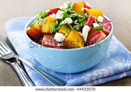 Bowl of roasted sliced red and golden beets - stock photo