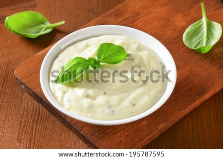 Bowl of salad dressing - stock photo
