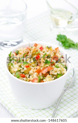 bowl of salad with bulgur, zucchini, tomatoes, chili peppers and parsley, vertical