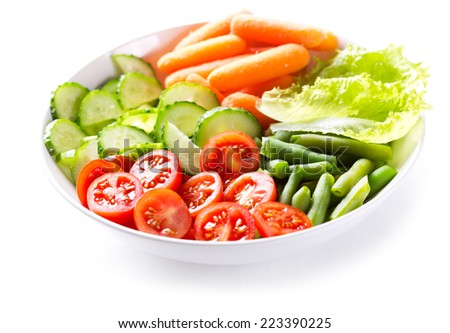 bowl of salad with fresh vegetables on white background