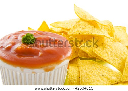 Bowl of sauce with tortilla chips on the background isolated over white - stock photo