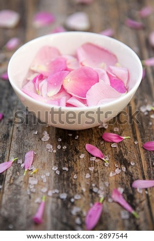 Bowl of scented rose petals - shallow depth of field - stock photo